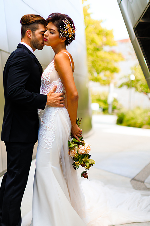 Downtown-los-angeles-wedding-shoot-at-oue-skyspace-bride-and-groom-hugging-front-view-close-up