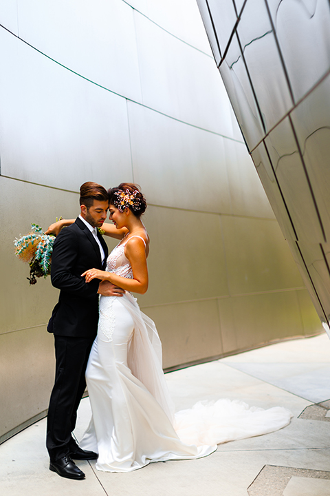 Downtown-los-angeles-wedding-shoot-at-oue-skyspace-bride-and-groom-hugging-front-view-smiling