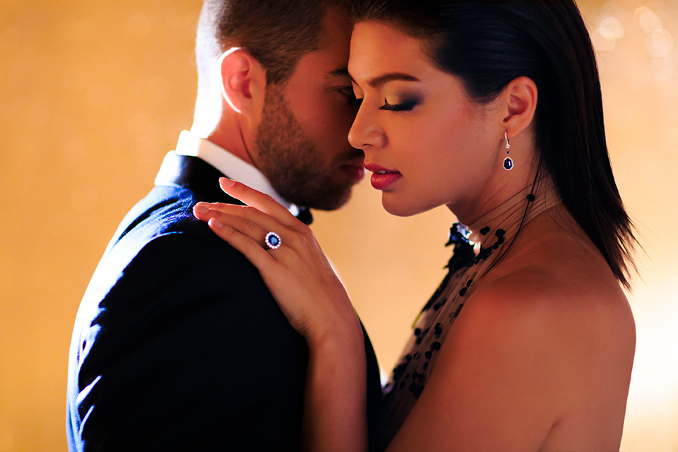 Downtown-los-angeles-wedding-shoot-at-oue-skyspace-bride-and-groom-standing-hugging-close-up