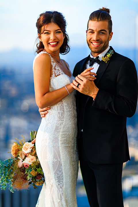 Downtown-los-angeles-wedding-shoot-at-oue-skyspace-ceremony-bride-and-groom-hugging-smiling