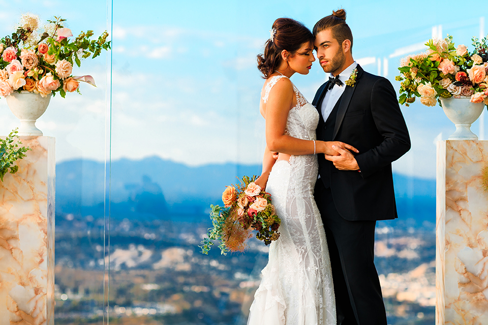 Downtown-los-angeles-wedding-shoot-at-oue-skyspace-ceremony-bride-and-groom-hugging