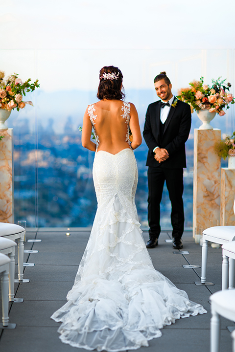 Downtown-los-angeles-wedding-shoot-at-oue-skyspace-ceremony-bride-and-groom-walking-down-the-aisle-smiling