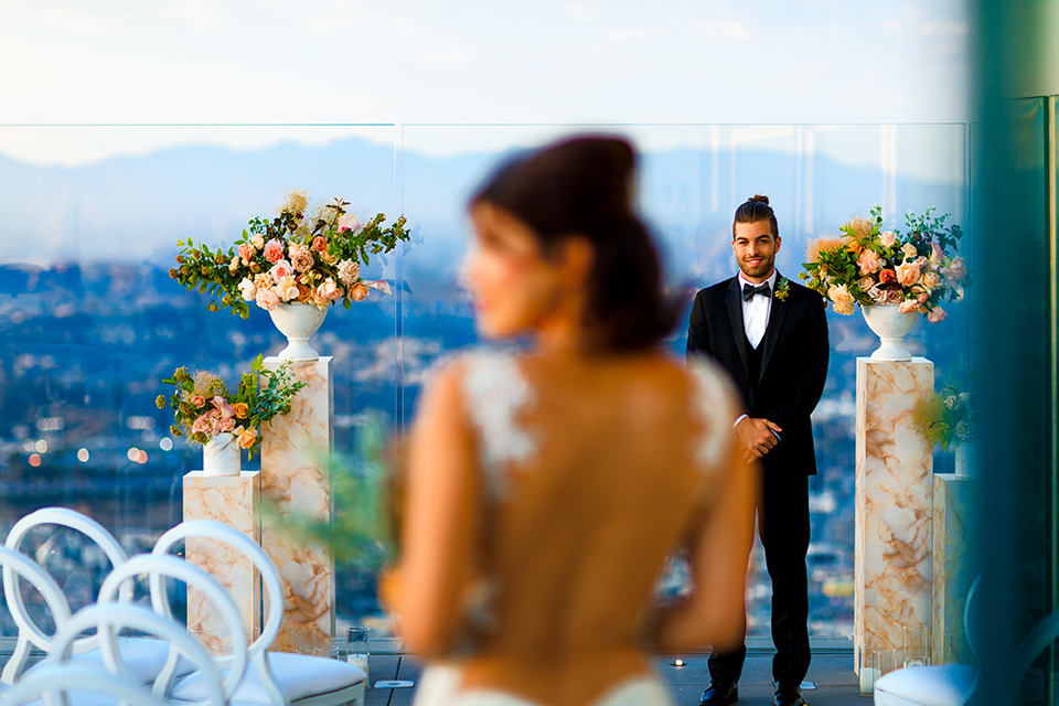 Downtown-los-angeles-wedding-shoot-at-oue-skyspace-ceremony-bride-and-groom-walking-down-the-aisle