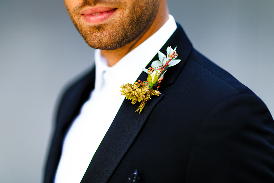 Downtown-los-angeles-wedding-shoot-at-oue-skyspace-groom-black-tuxedo-close-up
