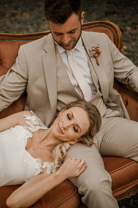 Texas-peaches-and-cream-wedding-shoot-at-carola-horse-ranch-bride-and-groom-sitting-on-couch-close-up