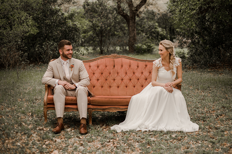 Texas-peaches-and-cream-wedding-shoot-at-carola-horse-ranch-bride-and-groom-sitting-on-couch