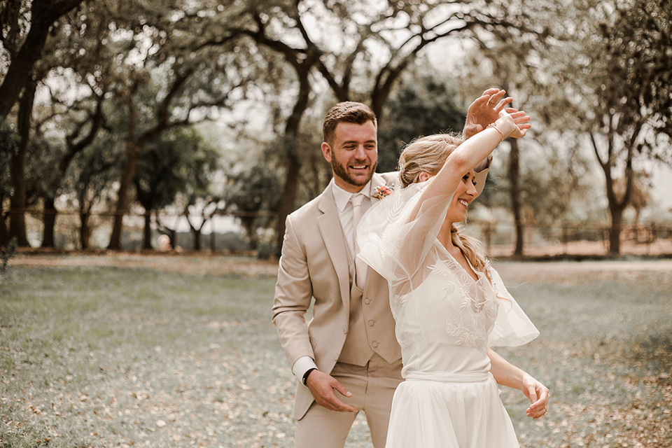 Texas-peaches-and-cream-wedding-shoot-at-carola-horse-ranch-bride-and-groom-standing-dancing