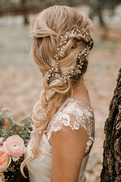 Texas-peaches-and-cream-wedding-shoot-at-carola-horse-ranch-bride-close-up-on-hair