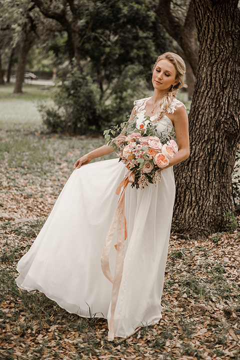 Texas-peaches-and-cream-wedding-shoot-at-carola-horse-ranch-bride-holding-bouquet