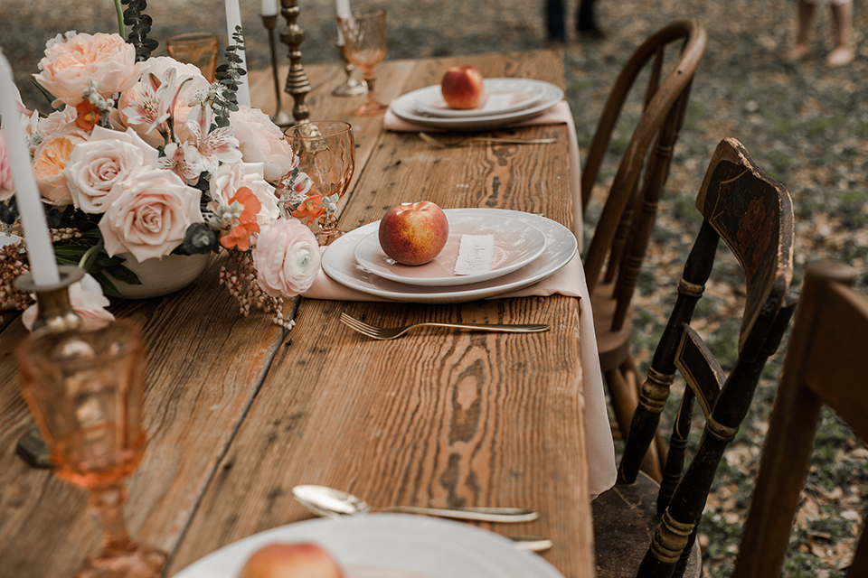 Texas-peaches-and-cream-wedding-shoot-at-carola-horse-ranch-table-set-up-with-place-setting-and-flowers