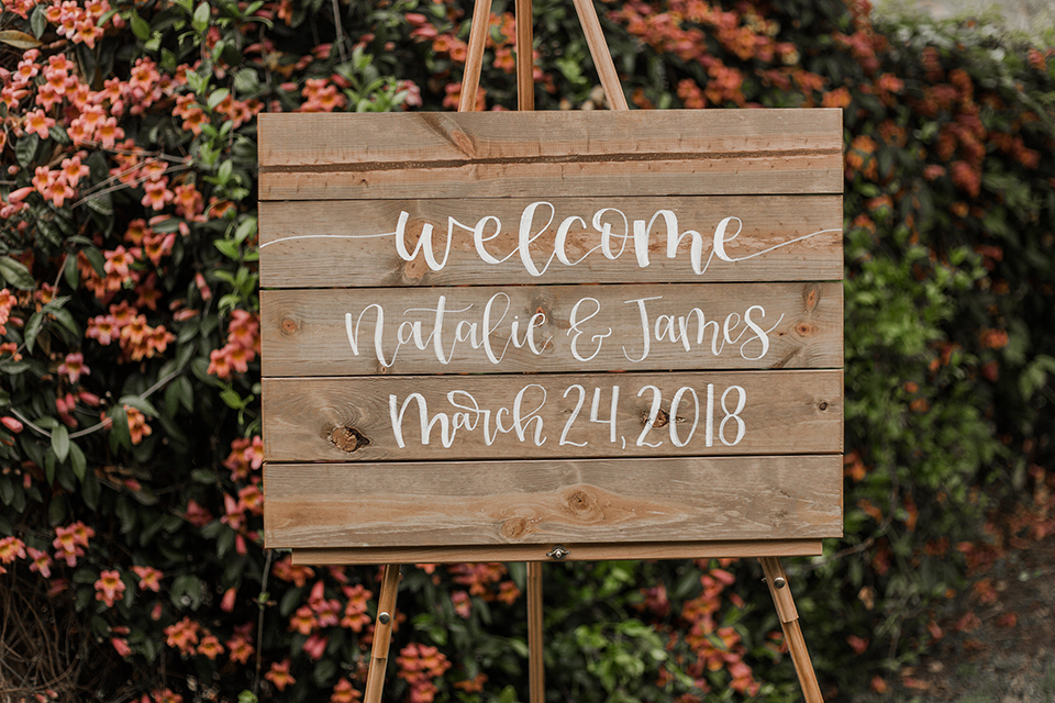 Texas-peaches-and-cream-wedding-shoot-at-carola-horse-ranch-wedding-welcome-sign