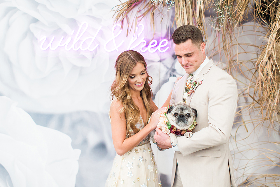 Los-angeles-garden-wedding-at-retreat-malibu-bride-and-groom-lounge-holding-dog
