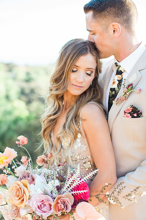 Los-angeles-garden-wedding-at-retreat-malibu-bride-and-groom-standing-hugging-and-kissing