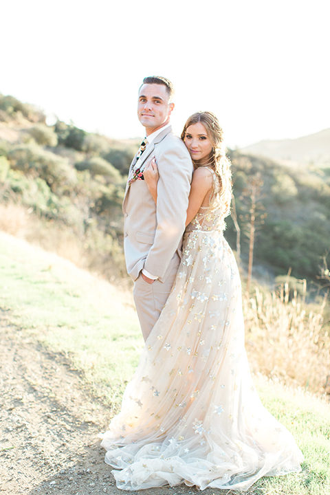 Los-angeles-garden-wedding-at-retreat-malibu-bride-and-groom-standing-hugging-and-smiling