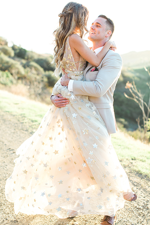 Los-angeles-garden-wedding-at-retreat-malibu-bride-and-groom-standing-hugging-bride