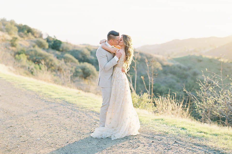 Los-angeles-garden-wedding-at-retreat-malibu-bride-and-groom-standing-kissing