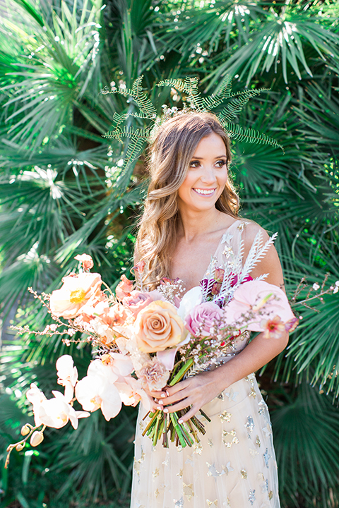 Los-angeles-garden-wedding-at-retreat-malibu-bride-holding-bouquet-smiling