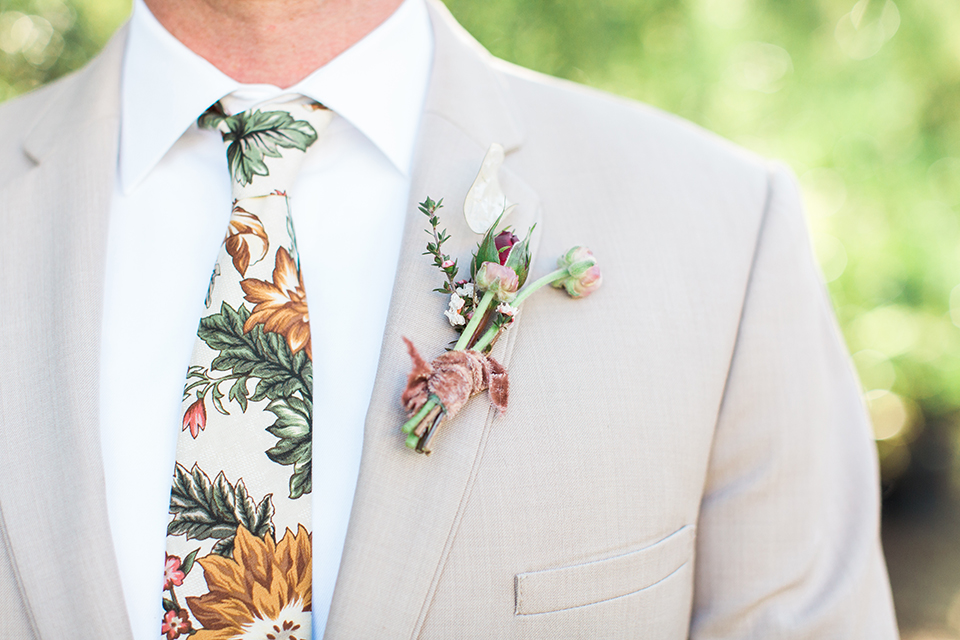 Los-angeles-garden-wedding-at-retreat-malibu-groom-tan-suit-with-floral-tie-close-up