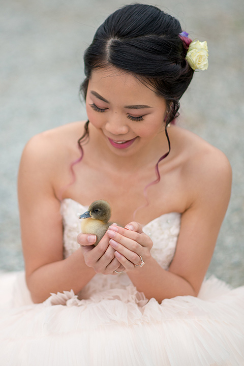 temperino-ranch-wedding-bride-with-baby-animal-bride-in-a-lace-dress-with-straps-and-hair-pulled-back