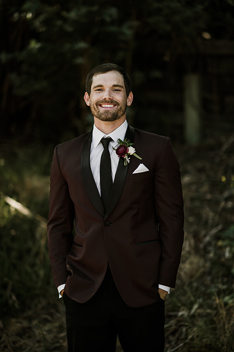 saddle-peak-groom-smiling-groom-in-a-burgundy-tuxedo-with-a-long-tie