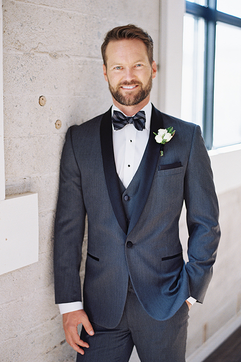 Same-sex-industrial-wedding-at-the-1912-groom-charcoal-tuxedo-close-up
