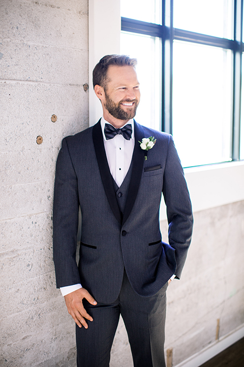 Same-sex-industrial-wedding-at-the-1912-groom-charcoal-tuxedo