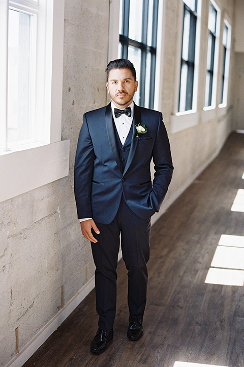 Same-sex-industrial-wedding-at-the-1912-groom-navy-tuxedo-standing