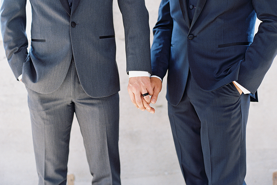 Same-sex-industrial-wedding-at-the-1912-grooms-holding-hands-outside-close-up