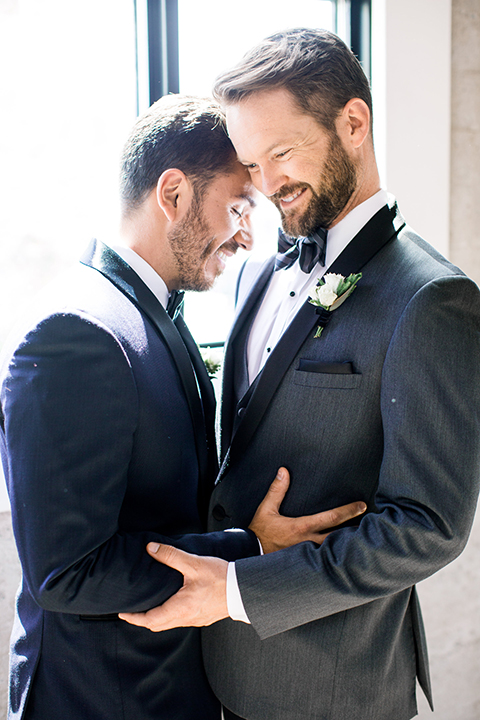 Same-sex-industrial-wedding-at-the-1912-grooms-hugging