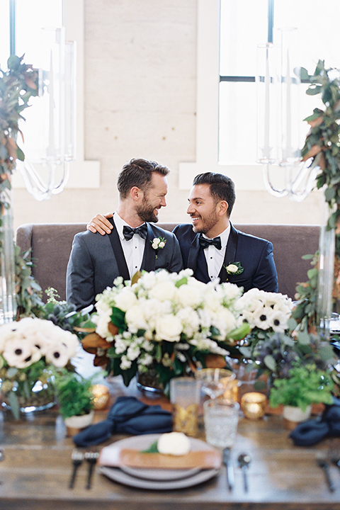 Same-sex-industrial-wedding-at-the-1912-grooms-sitting-at-table