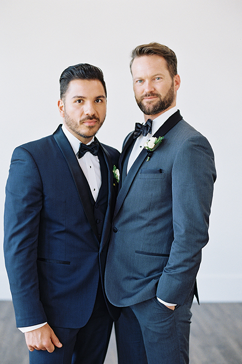 Same-sex-industrial-wedding-at-the-1912-grooms-standing-and-hugging