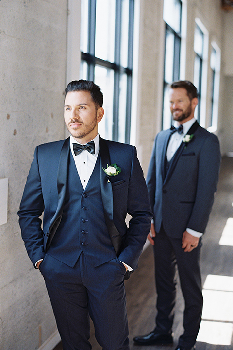 Same-sex-industrial-wedding-at-the-1912-grooms-standing