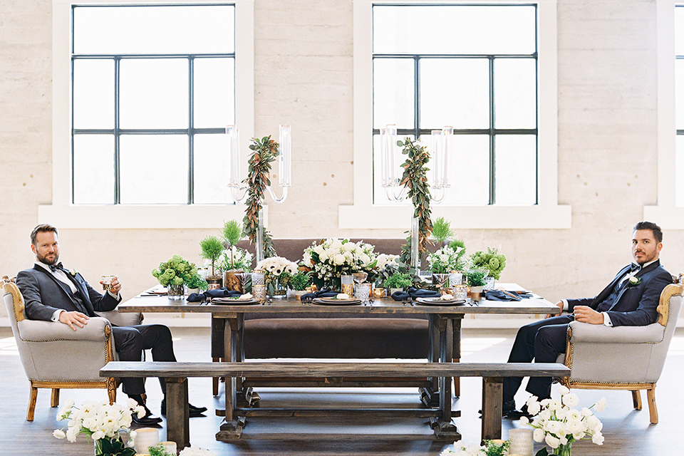 Same-sex-industrial-wedding-at-the-1912-table-set-up-grooms-sitting-across-table