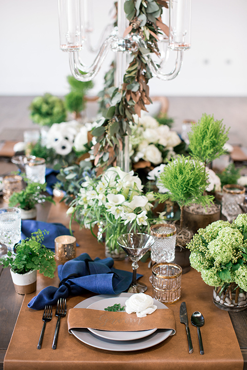 Same-sex-industrial-wedding-at-the-1912-table-set-up-with-flowers-and-place-settings