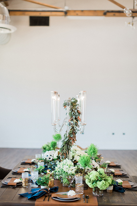 Same-sex-industrial-wedding-at-the-1912-table-set-up-with-flowers