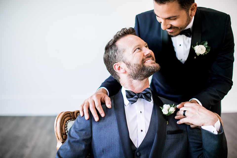 Same-sex-industrial-wedding-grooms-holding-hands-smiling