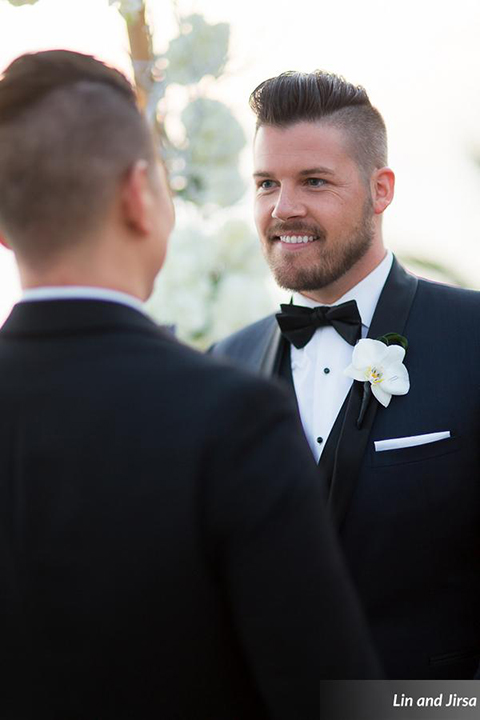Laguna-beach-outdoor-wedding-same-sex-ceremony-grooms-holding-hands-smiling