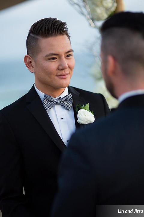 Laguna-beach-outdoor-wedding-same-sex-ceremony-grooms-holding-hands
