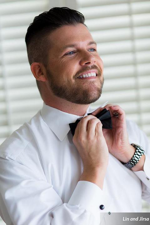 Laguna-beach-outdoor-wedding-same-sex-groom-getting-ready-bow-tie