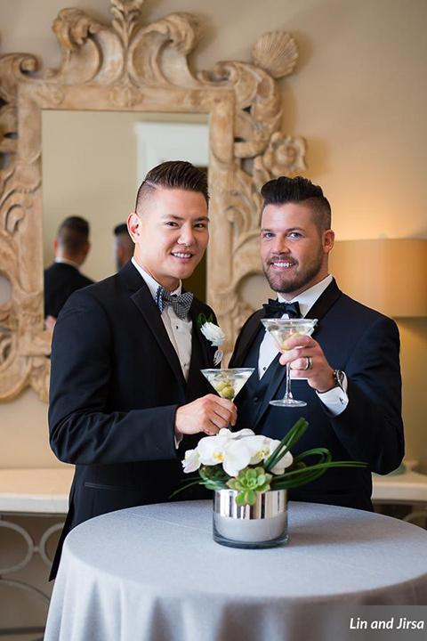 Laguna-beach-outdoor-wedding-same-sex-grooms-holding-drinks
