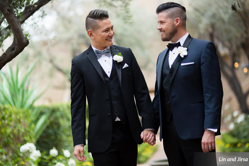 Laguna-beach-outdoor-wedding-same-sex-grooms-holding-hands-and-smiling