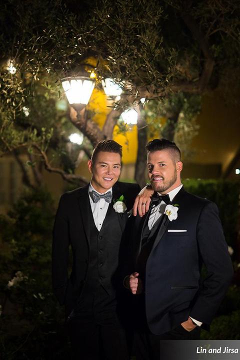 Laguna-beach-outdoor-wedding-same-sex-grooms-standing-smiling