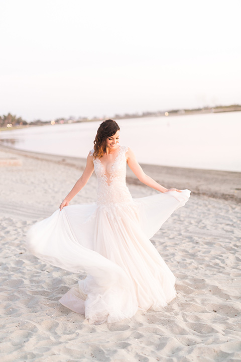 san-diego-styled-shoot-bride-twirling-bride-in-a-lace-gown-with-sleeves-groom-inan-grey-tuxedo-with-a-black-shawl-lapel