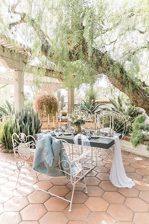 Sherman-library-and-gardens-wedding-table-set-up-with-metal-chairs