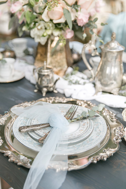Sherman-library-and-gardens-wedding-table-set-up-close-up-on-silverware-with-blue-tulle