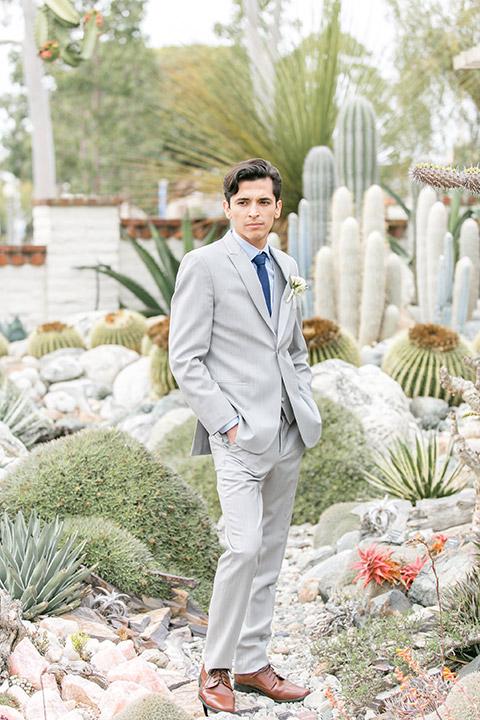 Sherman-library-and-gardens-groom-look-standing-on-rcks-in-cacti