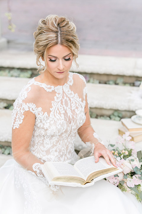 Sherman-library-and-gardens-bride-ball-gown-reading-a-book