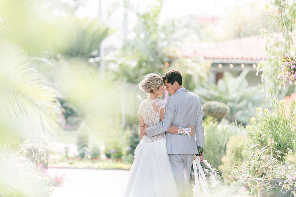 Sherman-library-and-gardens-couple-walking-away-from-camera