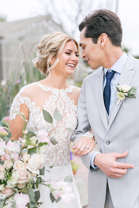 Sherman-library-and-gardens-bride-and-groom-laughing-looking-down-at-each-other