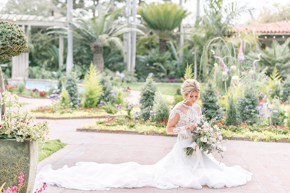 Sherman-library-and-gardens-bride-on-the-floor-gown-all-around-her